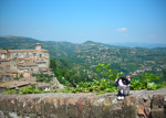 Tuxedo Janelle takes a break above the Umbrian Valley in Perugia