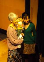Kathy Chisholm, event organizer with bouquet and Sari Tomomi, belly dancer