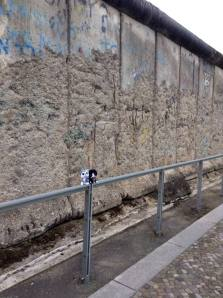 Minions pose beside the Berlin Wall